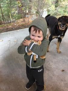 Reunited- Jaxson gives Baby Meow a welcome home hug.