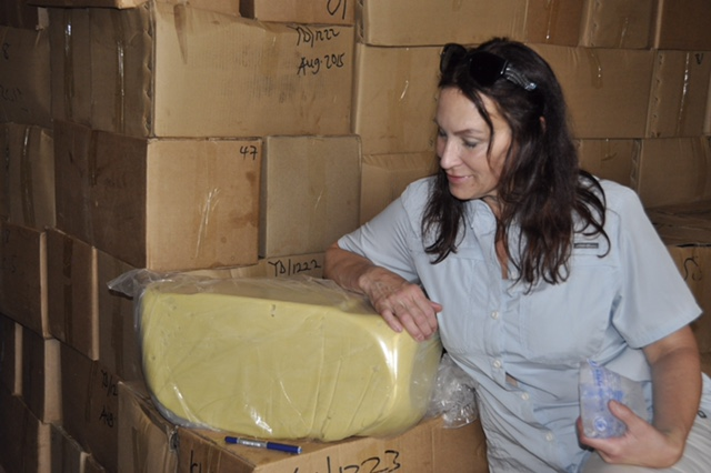 Andrea in front of a package of creamy, refined shea butter produced in Wechiau's new factory.