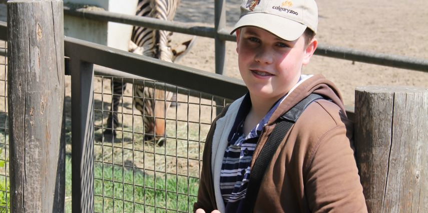 Adam Fisher, 13, enjoy a zoo camp with a visit to the zebras.
