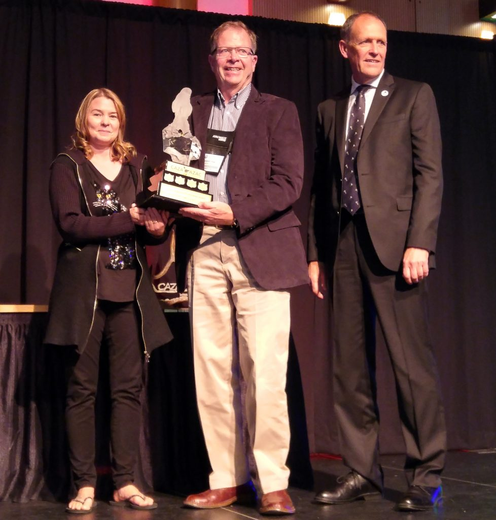 Zoo animal care staff members Colleen Baird and Bob Peel accept Rick Wenmen's CAZA award on his behalf.