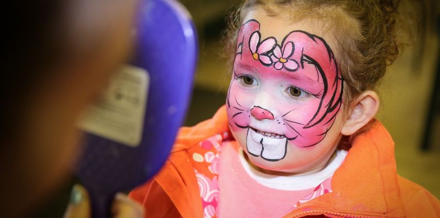 Face painting at Easter Eggstravaganza. Photo Credit: Sergei Belski